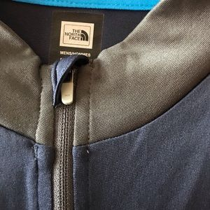 Men's The North Face zippered pullover shirt.